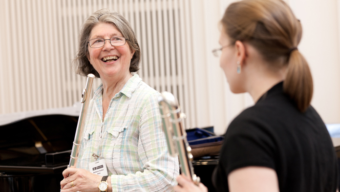 undefinedFlute Player and teacher laughing